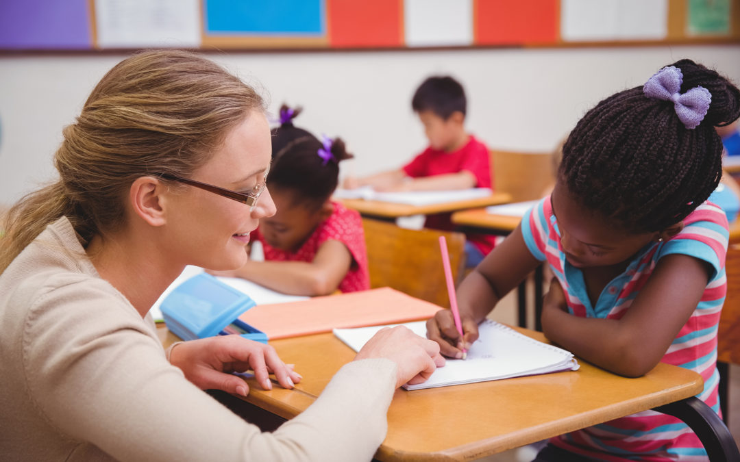 Teacher instructing a child