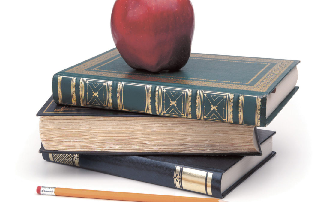 An apple on leather bound books